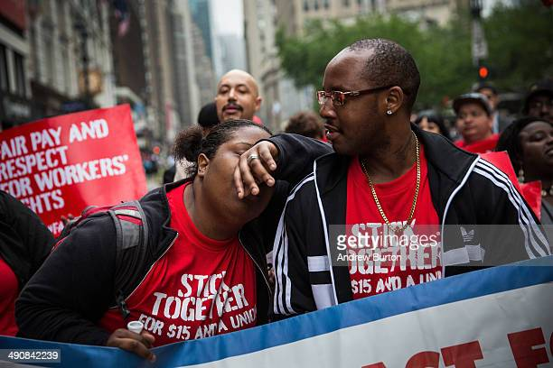 A protester demanding higher wages for fast food workers takes a brief moment of rest during a massive rally on May 15 2014 in New York City Fast...