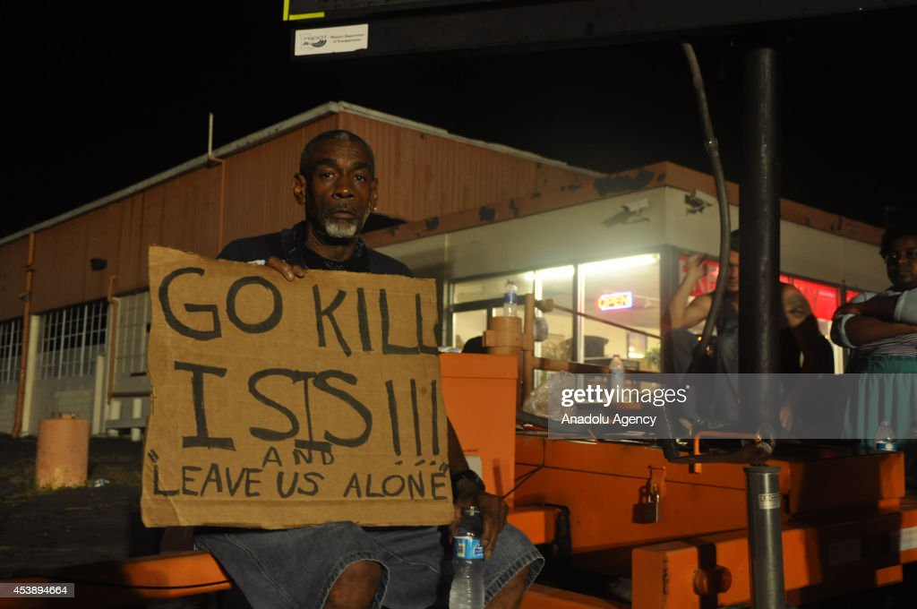 A protester demonstrates against the death of Michael Brown in the Saint Louis suburb of Ferguson, Missouri, on August 20, 2014. Eighteen-year-old unarmed teen was shot dead by police in the St. Louis suburb of Ferguson, Missouri on August 09, 2014.