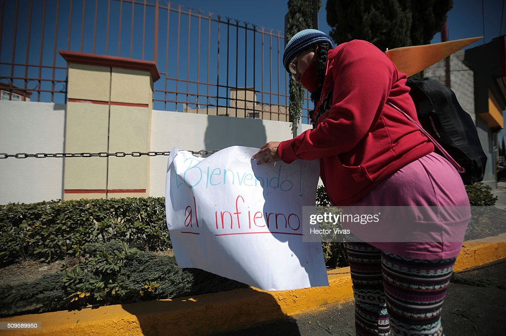 A protester displays a banner near the esplanade where Pope Francis will give a mass for 300 thousand people during the preparations ahead the visit of Pope Francis to Mexico at Las Americas on February 11, 2016 in Ecatepec, Mexico.