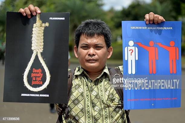 A protester displays a placard that reads ''death row is a murder and death penalty is not justice' during an antideath penalty rally in front of the...