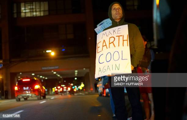 A protester displays a sign in support of the environment during a rally against climate change in San Diego California on February 21 2017 The US...
