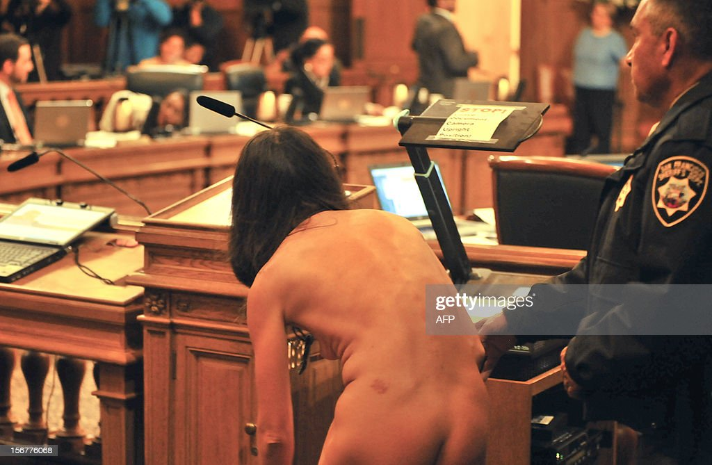 A protester disrobes inside San Francisco's City Hall after the Board of Supervisors approved a ban on public nudity on November 20, 2012. San Francisco lawmakers voted to outlaw most public nudity, despite protests in the famously free and easy California city -- including a naked demo outside City Hall. The city's Board of Supervisors approved a ban proposed by Scott Wiener; its Castro neighborhood is a gay hub where so-called Naked Guys regularly hang out. The law was approved by 6 votes in favor to 5 against at an afternoon meeting, at which Wiener said the move was long overdue. AFP PHOTO/Josh Edelson