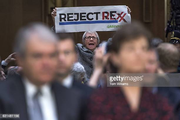 A protester disrupts the Senate Foreign Relations Committee confirmation hearing for Secretary of State nominee Rex Tillerson in Dirksen Building...
