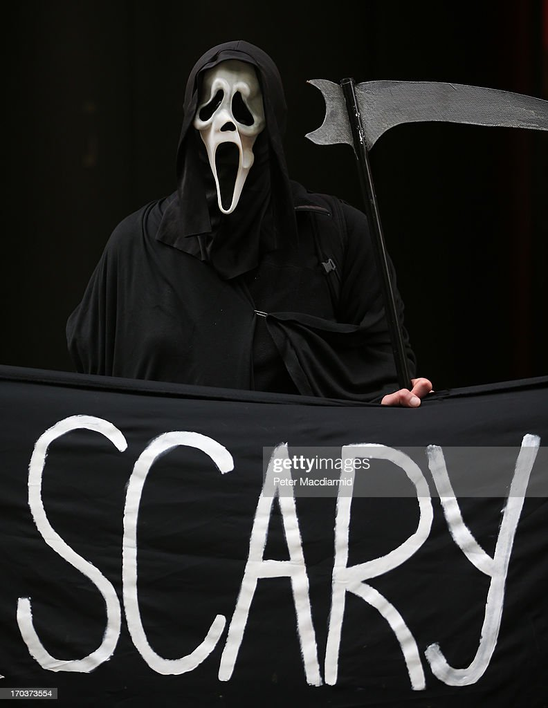 A protester dressed as the Grim Reaper stands outside arms manufacturer BAe Systems on June 12, 2013 in London, England. Protests are expected to take place in London in the lead up to the G8 meeting to be held in Enniskillen, Northern Ireland on the 17 and 18 June 2013. The chosen location is only 8 kilometers from the scene of one of Northern Ireland's worst killings back in 1987, however Cameron is confident that it's secluded location will deter any potential trouble.