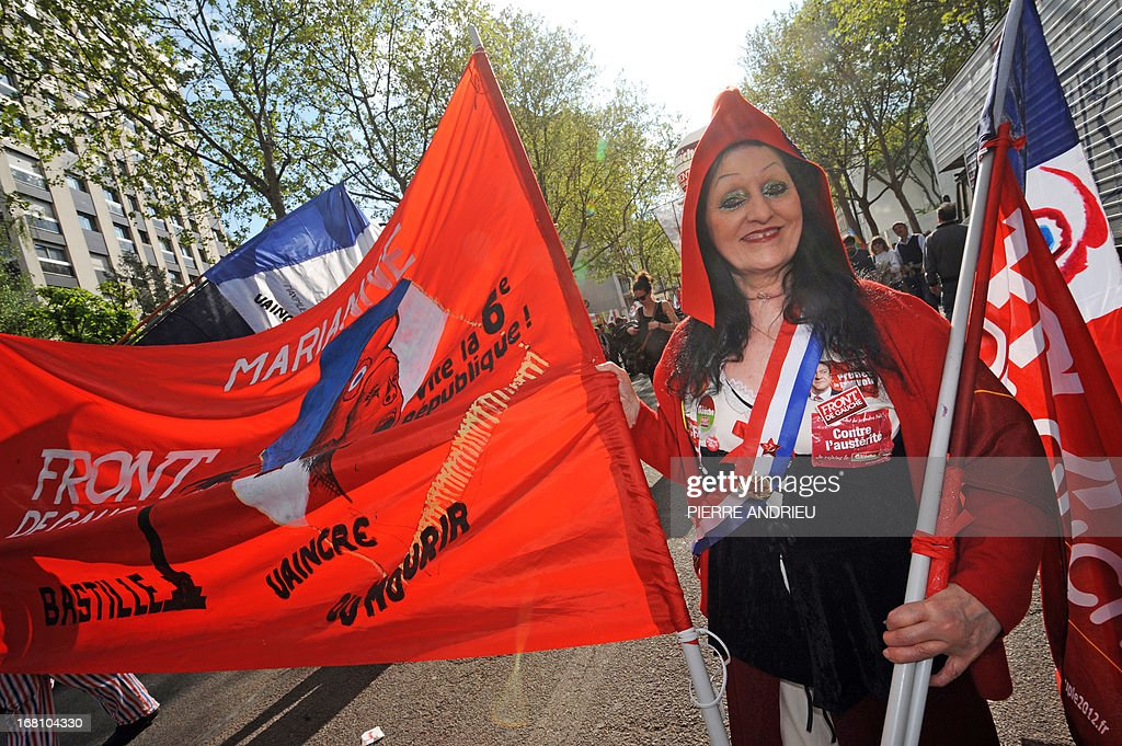A protester dressed up as Marianne, a personification of the French Republic, take part in a demonstration on May 5, 2013 in Paris, called by Jean-Luc Melenchon, leader of Front de Gauche (Left Front) left wing party, to protest 'against the austerity, against the finance and to ask for a Sixth Republic'. When France's president Francois Hollande swept to power on May 2012 on a wave of discontent, he could hardly have imagined that a year later he would be the most unpopular president in modern French history.