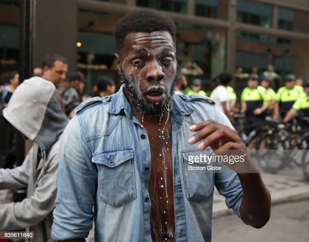 A protester drips of milk after being maced on Washington Street in the tense situations that broke out following the 'Boston Free Speech' rally and...