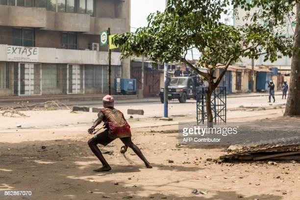 A protester faces security forces during clashes as part of an antigovernment protest in Lome on October 18 2017 Protesters erected makeshift...