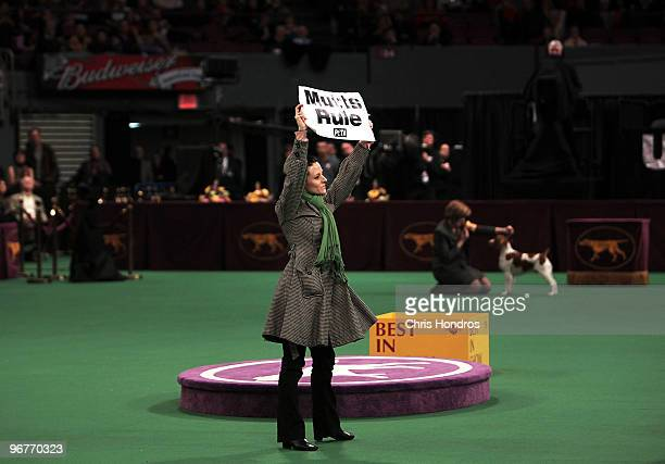 A protester from group People for the Ethical Treatment of Animals holds up a sign on the floor at the Westminster Kennel Club Dog Show February 16...