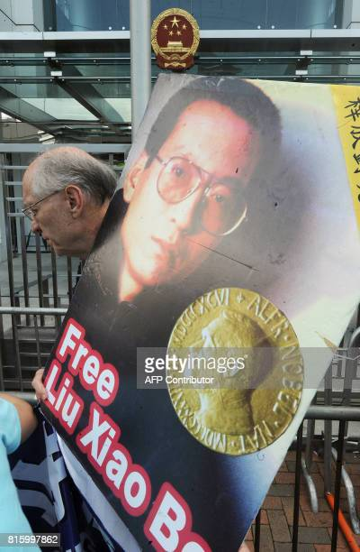 A protester from Hong Kong's Democratic Party and China Human Rights Lawyers Concern Group joins a demonstration calling for the release of jailed...