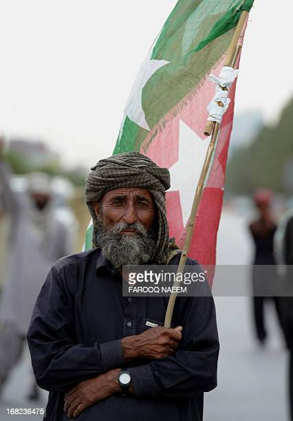 A protester from the Pakistani Bugti tribe holds a flag on constitution avenue during a protest in Islamabad on May 7 2013 Around 300 Bugti tribesmen...
