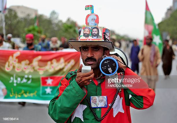 A protester from the Pakistani Bugti tribe marches towards constitution avenue in Islamabad on May 7 2013 Around 300 Bugti tribesmen marched...