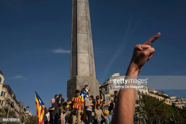 Protester gesture at a hovering police helicopter as massive crowd rally to demand the release of imprisoned Catalan leaders Jordi Sanchez and Jordi...