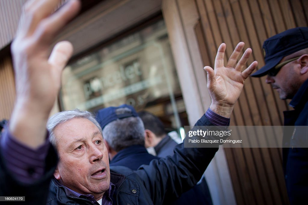 A protester gestures outside the PP Headquarters before the PP national executive comitee on February 2, 2013 in Madrid, Spain. Spanish reports alleged Rajoy and other conservative politicians received regular payments from a previously undisclosed account run by the treasurers of his Popular Party from 1990 to 2008.