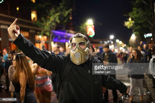 A protester gestures toward the police line during the fourth night of demonstrations over recent grand jury decisions in policeinvolved deaths on...