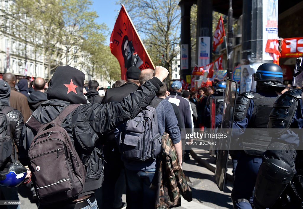 A protester gestures towards French anti riot police during the traditional May Day demonstration in Paris on May 1, 2016.