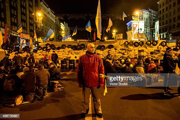 A protester guards the makeshift barricade near Khreshchatyk street on Maidan Square on December 14 2013 in Kiev Ukraine Antigovernment protests...