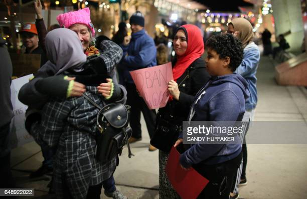 Protester Heddy Smith hugs a young Muslim girl during a rally against the travel ban at San Diego International Airport on March 6 2017 in San Diego...
