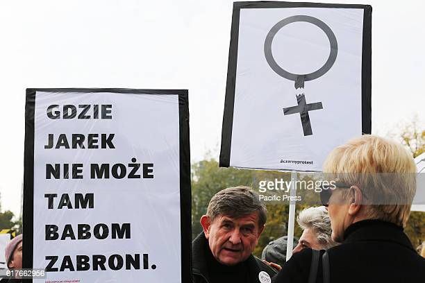 A protester hold up signs that read 'Where Jarek can't go he will forbid women' during a 'black protest' in Warsaw Poland on October 23 2016 in front...