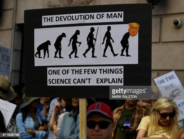 A protester holds a antiTrump sign during the March for Science in Los Angeles California on April 22 2017 Thousands of people joined a global March...