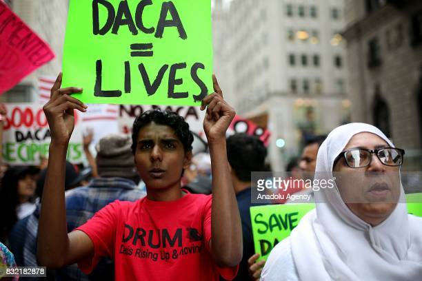 A protester holds a banner reading 'DACA = Lives' during a rally against US President Donald J Trump's potential repealing of Deferred Action for...