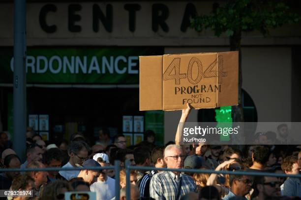 A protester holds a banner reading 'error 404 program not found' during the meeting The French presidential candidate Emmanuel Macron held its last...