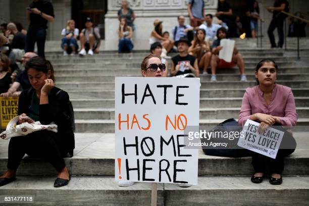 A protester holds a banner reading 'Hate Has No Home Here' during a rally against US President Donald J Trump for threating North Korea and Venezuela...
