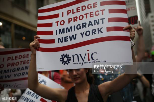 A protester holds a banner reading 'I Pledge To Protect Immigrant New York' during a rally against US President Donald J Trump's potential repealing...