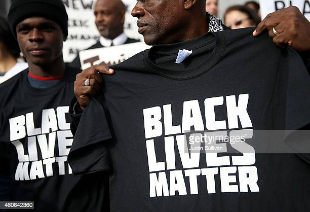 A protester holds a black lives matter tshirt during a 'Hands Up Don't Shoot' demonstration in front of the San Francisco Hall of Justice on December...
