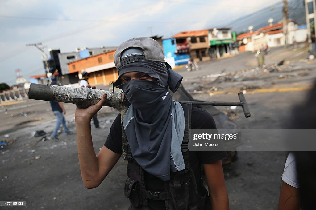 A protester holds a homemade mortar tube during an anti-govenment protest on March 7, 2014 in San Cristobal, Venezuela. Protesters have set up barricades throughout San Cristobal, the capital of Venezuela's Tachira state, bordering Colombia. The state has been a focal point for anti-government protests for almost a month.