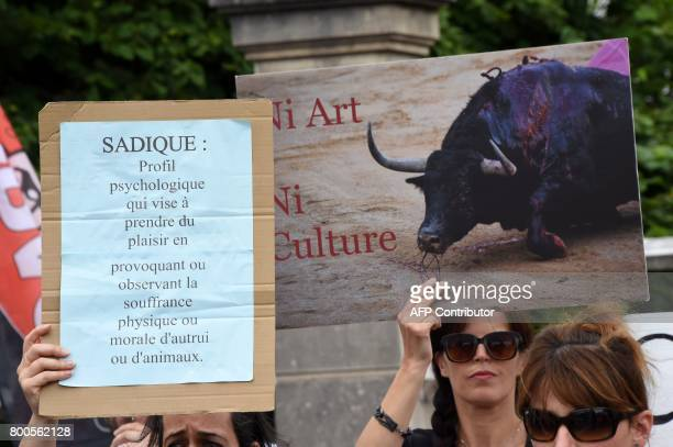 A protester holds a placard during a demonstration against bullfighting on June 24 2017 in the French city of La Brede western France Around 60...