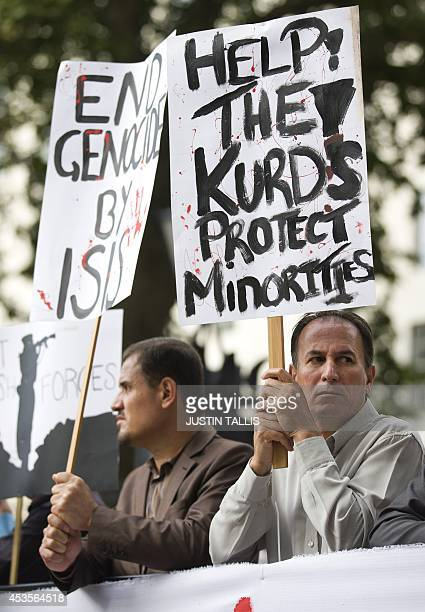 A protester holds a placard during a demonstration against the killing of Yazidi's by Islamic State fighters in northern Iraq outside Downing Street...