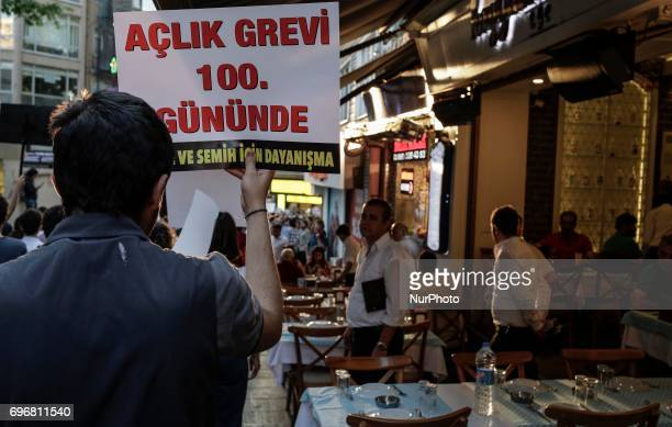 A protester holds a placard during a protest in support of sacked academic Nuriye Gulmen and primary school teacher Semih Ozakca who were arrested by...