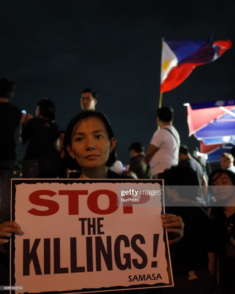 A protester holds a placard during a rally against extrajudicial killings in Quezon City, east of Manila, Philippines on Monday, 21 August 2017. The death of Kian Delos Santos, who was killed by policemen in an alleged shootout, has sparked protests and condemnation from the public against alleged extrajudicial killings on drug users and pushers.