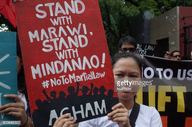 A protester holds a placard during a rally coinciding the joint session on Martial Law extension outside the House of Representatives in Quezon City...