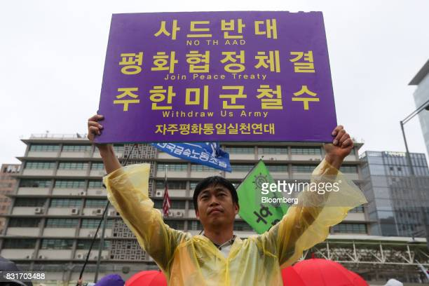 A protester holds a placard in front of US embassy during a rally against the deployment of the Terminal HighAltitude Area Defense system in Seoul...