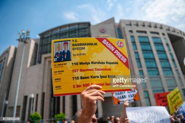 A protester holds a placard reading ' 110 media companies closed 157 journalists are jailed 715 press cards are cancelled 2500 journalists lost their...