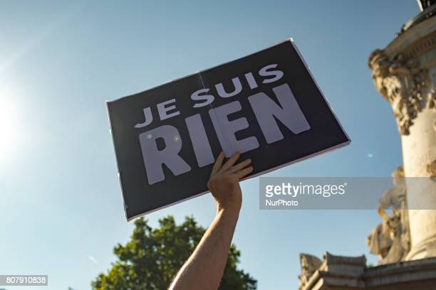 A protester holds a placard reading quotI am Nothingquot as people gather to listen to La France Insoumise leftist party's leader delivering a speech...