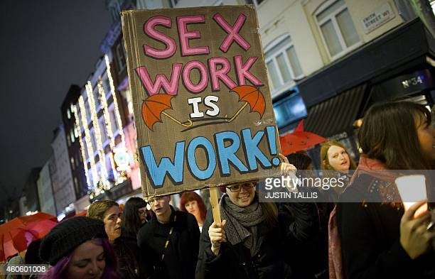 A protester holds a placard whilst marching through Soho after a candlelit vigil to mark the international day to end violence against sex workers...