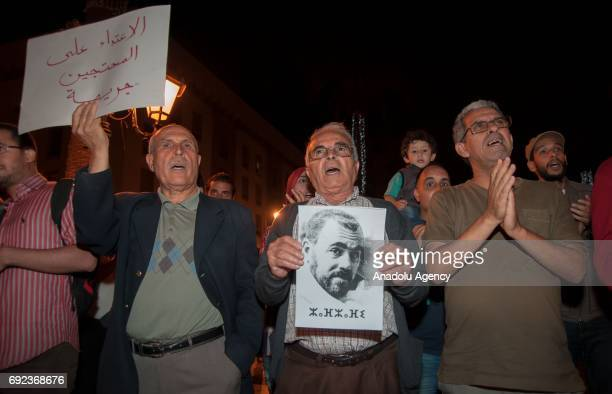 A protester holds a portrait of grassroots leader Nasser Zefzafi during a demonstration in solidarity with Morocco's neglected Rif region in Rabat...
