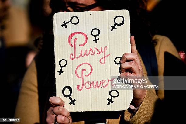 A protester holds a poster during a march in central Lisbon on January 21 2017 in a mark of solidarity for the political rally promoting the rights...