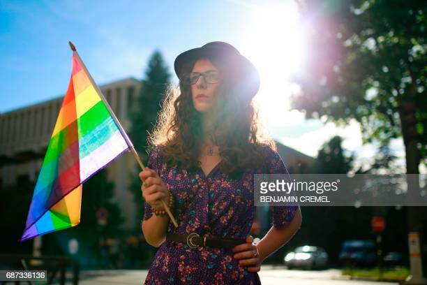 A protester holds a rainbow flag during a demonstration in support of gay rights and against homophobia in Chechnya in front of the Russian Embassy...