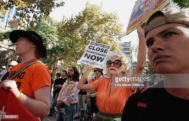 A protester holds a sign in support of Guantanomo Bay detainee and convicted terrorism supporter David Hicks April 21 2007 in Sydney Australia Hicks...