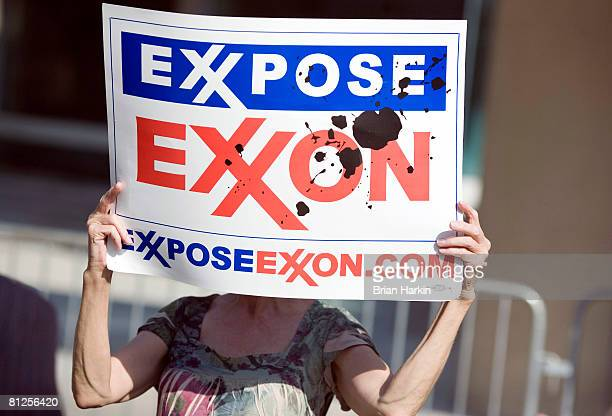 A protester holds a sign outside of the ExxonMobil annual shareholders meeting at the Morton H Meyerson Symphony Center May 28 2008 in Dallas Texas A...