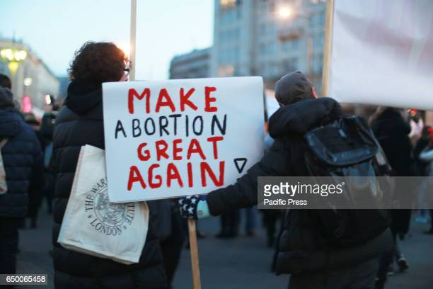 A protester holds a sign that reads 'Make abortion great again' during a massive demonstration on International Women's Day in Warsaw Poland