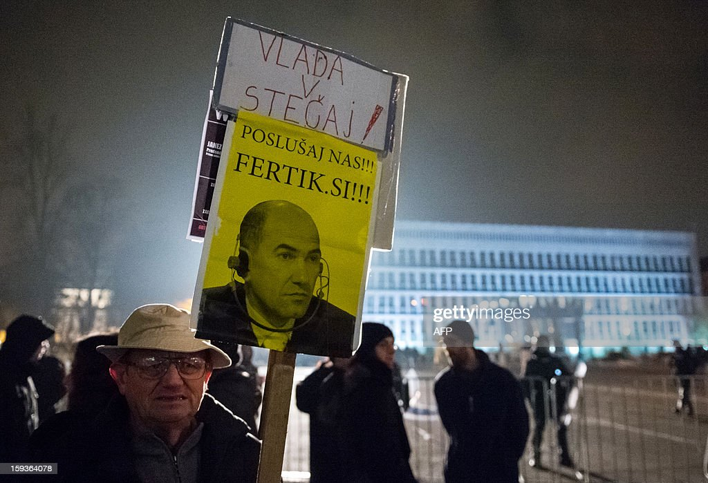 A protester holds a sign with an image of Slovenian Prime Minister Janez Jansa and reading 'Listen to us, you are done' during a demonstration against political corruption and the Prime Minister in Ljubljana, on January 11, 2013. Several thousand people in Slovenia's capital today joined in one of the biggest anti-government rallies in recent months, demanding the resignation of Prime Minister Janez Jansa, who has been accused of corruption. State radio estimated over 10,000 people took part in the protest called by civil groups under the slogan 'For the government's resignation and the renewal of Slovenia.' Police put the figure closer to 8,000. AFP PHOTO / Jure Makovec