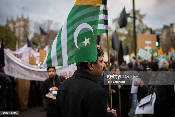 A protester holds a the flag of Azad Jammu and Kashmir a selfgoverning administrative division of Pakistan during a protest on Whitehall against the...