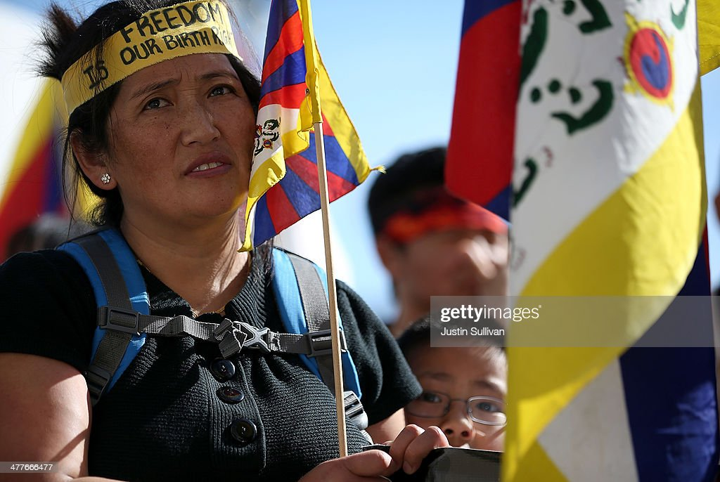A protester holds a Tibetan flag during a demonstration outside of San Francisco City Hall on March 10, 2014 in San Francisco, California. Hundreds of activists marked the 55th anniversary of the 1959 Tibetan uprising and the fifth anniversary of Tibetan self-immolation protests in Tibet.