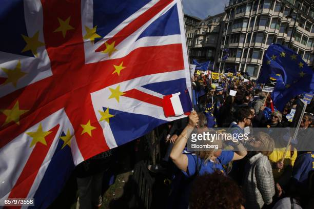 A protester holds a Union flag also known as Union Jack adorned with the stars of the European Union during a Unite for Europe march to protest...