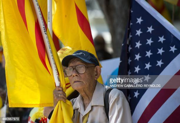 A protester holds a Vietnamese flag red flag with gold star designed in 1940 and used during an uprising against French rule in southern Vietnam...