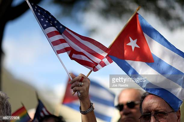 A protester holds an American flag and a Cuban one as she joins with others opposed to US President Barack Obama's announcement earlier in the week...